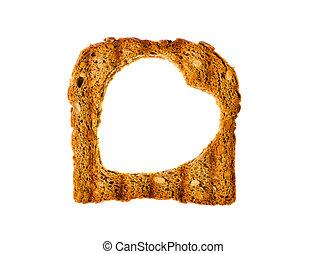 Delicious toast with a hole in the form of heart.