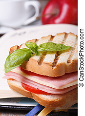 Delicious toast with ham and cheese on the background notebook