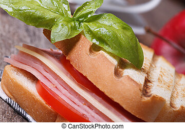toast with ham, cheese, tomatoes and basil