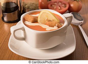 Delicious Tomato cream soup with crackers