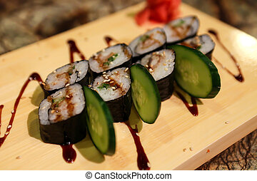 Delicious Unagi maki sushi rolls served with a wood plate.