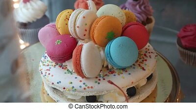 Delicious vanilla layered cake decorated macarons -...