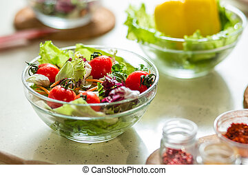 Delicious vegetable salad in glass bowl on the table