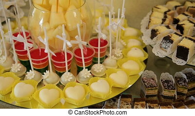 Delicious wedding reception candy bar dessert table.