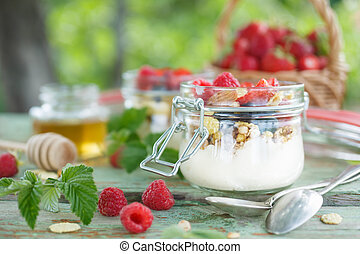 Delicious yogurt with raspberries in a serving jar
