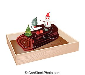 A Traditional Christmas Cake, Yule Log Cake or Buche de Noel in Wooden Box for Christmas Celebration.
