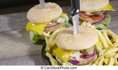 Delicous home made hamburger with fries on wooden table