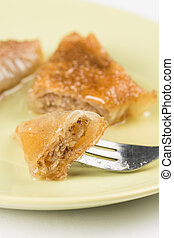 Delicous sweet tasty baklava with walnuts served on the plate