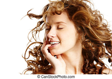 Delight - Image of beautiful young woman with curly hair