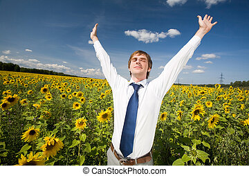 Delight - Portrait of delighted businessman with raised arms...