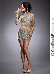 Delight. Respectable Woman in Evening Gown Drinking Champagne