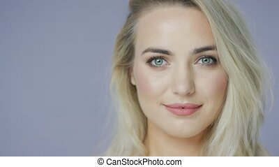 Delighted blonde woman in studio - Headshot of delighted...