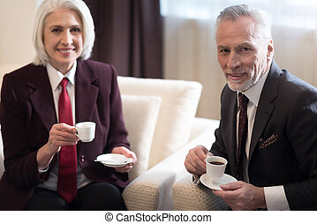 Delighted businesswoman having a break with her colleague
