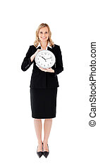 Delighted businesswoman holding a clock against white...