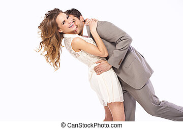 Delighted couple hugging each other - Delighted young couple...