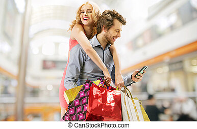 Delighted couple on the shopping - Delighted young couple on...