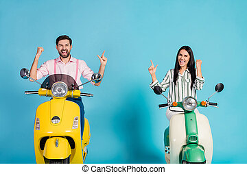 Delighted crazy two bikers riders drivers extreme sport lovers people celebrate victory motor bike ride lottery raise fists scream yes wear formalwear outfit isolated blue color background