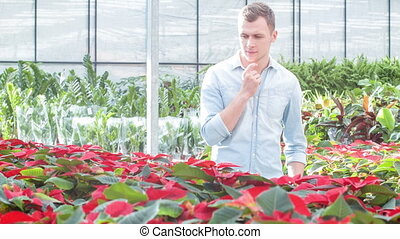 Delighted customer choosing a flower.