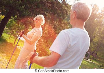 Delighted elderly family having a walk in fresh air