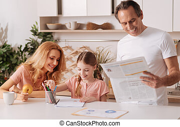 Delighted family enjoying morning routine at home