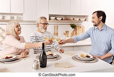 Delighted family having dinner at home