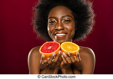 Delighted friendly woman offering you fresh fruits
