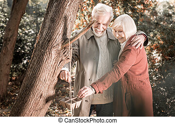 Delighted happy couple wanting to help birds - Special date....