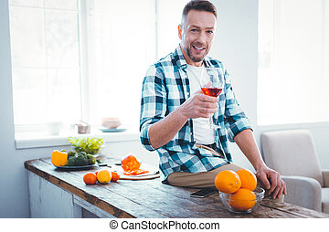 Delighted joyful man resting in his house
