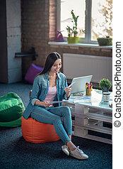 Delighted joyful young woman enjoying her work