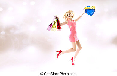 Delighted jumping lady with shopping bags - Delighted...