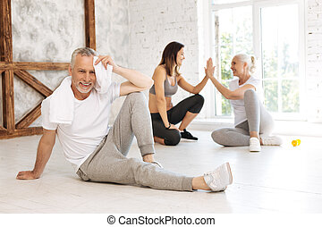 Delighted male person having rest after training
