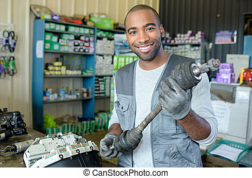 delighted man holding spare part