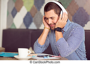 Delighted man listening to music - Feel the beat. Pleasant...