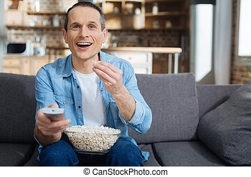 Delighted man spending weekend at home