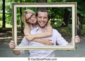 Delighted married couple taking a conceptual photo