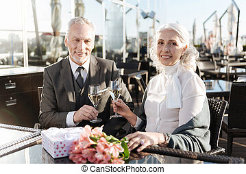 Delighted mature couple having appointment - Celebrating...