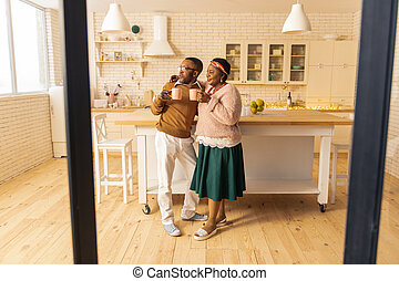 Delighted nice couple drinking tea in the morning
