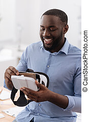 Delighted nice man being exited about new technology