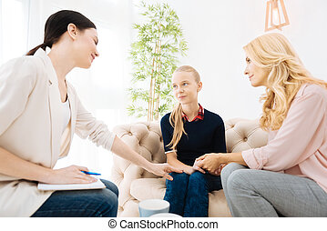 Delighted nice woman having a psychological session