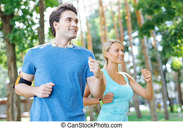 Delighted nice woman running with her boyfriend