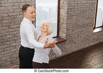 Delighted pensioners waltzing in the dance studio