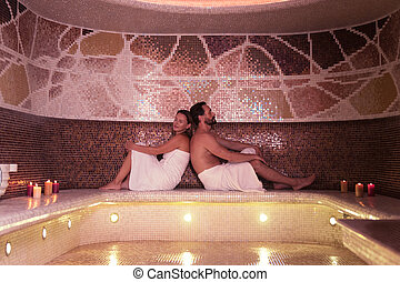 Delighted pleasant couple relaxing in the spa