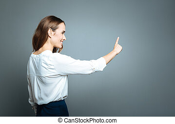 Delighted positive woman holding her arm