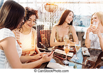Delighted positive women meeting at the restaurant