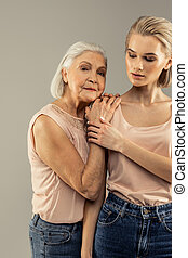 Delighted senior woman enjoying time with her daughter