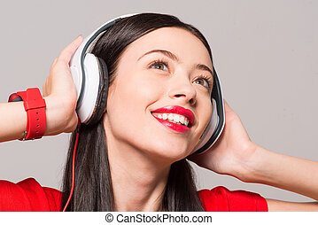 Delighted woman listening to music