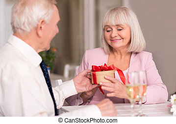 Delighted woman receiving gift