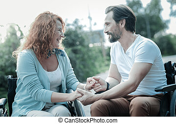Delighted woman spending time with her couple