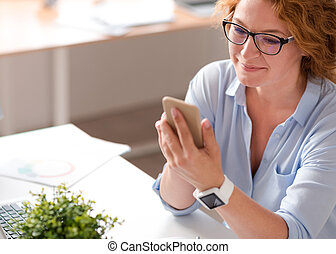 Delighted woman using cell phone