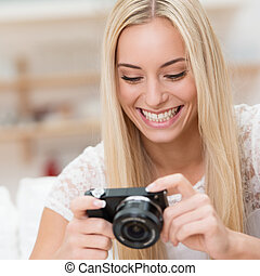 Delighted woman viewing a photo